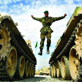 An Afghan soldier jumps from a 1960s era Soviet T62 battle tank while learning to repair them during training in the new Afghan National Army. Photograph/Benjamin Krain