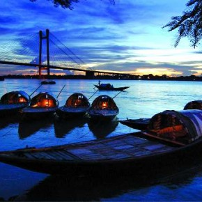 This wide angle approach to a few boats anchored on the shore of the Hooghly river, Kolkata, effectively captures the length of the boats, their dimly lit interiors, the bridge and the darkening evening sky. Photograph/Bikash Mondal