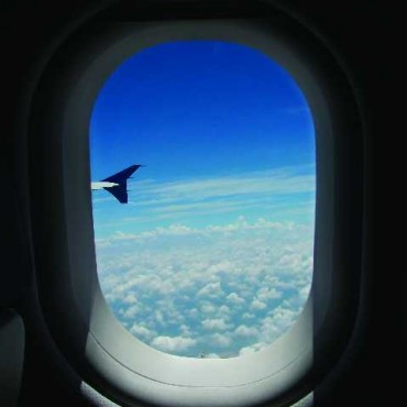 You can compose a frame by including the airplane window as well as the clouds outside. This creates a feeling of actually peeping through a window in the heavens. Exposure: 1/1250sec at f/4. Photograph/Bhaskar Dutta
