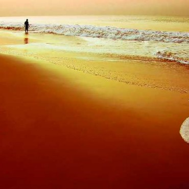 The sinuous, meandering curves of the waves lead the eye directly to the figure standing on the shore. Photograph/Nilesh J Bhange