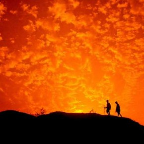 The warm reds and oranges of the sky alongwith soft clouds contrast vividly with the graphical silhouettes, making for a poignant composition. Photograph/Debashis Mukherjee