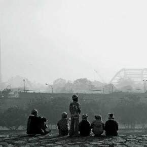 The warm clothes of the boys and the hazy atmosphere in the background tell the viewer that it was probably the season of winter when this group of kids decided to share a few moments of peace. Photograph/Mayank Khurana