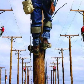 This image was taken in the Meter Pole Makeup Event, in Little Rock, USA. Linemen from around Arkansas show their skills in constructing, operating and maintaining power line systems on specially installed poles. Photograph/Benjamin Krain