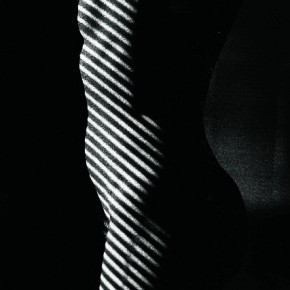 'Striped Nude' was shot in 1981. Ralph likes to think that the subject here is the light and the woman, the source of light. Photography/Ralph Gibson