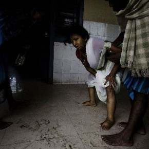 Rubi Devi is helped to the bathroom by her husband Sunil. Even basic facilities like a wheelchair and bed pan were lacking in the hospital. Photograph/Dhiraj Singh