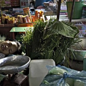 A street vendor takes a nap on a Sunday afternoon at the Russian markets in Phnom Penh, Cambodia. Photograph by/Mohammed Massoud Morsi