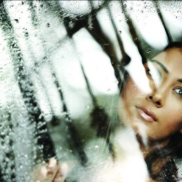 In this image, including the glass of the window with the raindrops brings out the emotions of the subject. Photograph/Pravin Talan