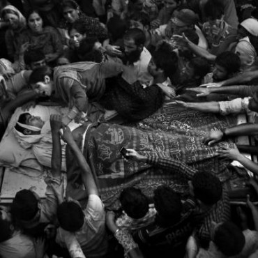 Qadri won the People in the News, Singles category for this poignant photograph of the funeral of a 16-yearold boy killed by the Special Operations Group of police in North Kashmir. Photograph/Altaf Qadri.