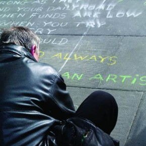 "Ireland, July 2010 This man wrote a poem on the street, in Dublin. Only after shooting the picture did Pierre realise that most of the words were hidden by the man's body. What was visible: ""Always an artist"", gave the image new meaning. Photograph/Pierre Poulain"