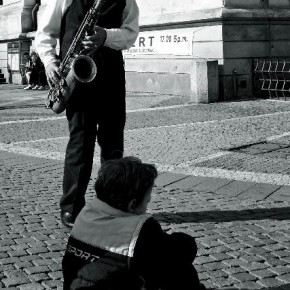 "Prague, Czech republic, October 2010 ""Like a freely consented master-disciple relation, the child sits to listen to the music while the old man pays all his attention to educate the child,"" Pierre observes. Photograph/Pierre Poulain"