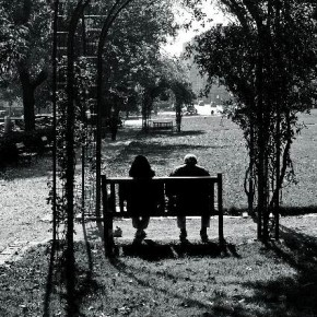 "Czech Republic, October 2010 For Pierre, this photo is like the enigma of life. To him, it seemed that a mirror had been placed between the couple. ""Though they sit together, each one is alone,"" he says. Photograph/Pierre Poulin"