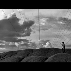 "Title: Lines and Miles ""I was moving around during one of my shoots, when I spotted this boy climbing up the hillock. The electric wires and his placement in the frame seemed just right when I released the shutter."" Camera: Sony Cyber-shot DSC-W180 ISO: 400 Aperture: f/4 Shutterspeed: 1/10sec Photograph/M Dharmendra Singh K, Manipur"