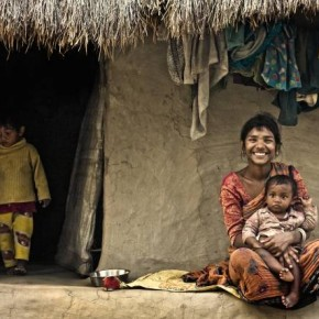 """Title: Priceless Smiles """"I went to Gaurdaha, a small village in West Bengal, to capture the rural life. It is there that I found this lady with her two children smiling unabashedly into the camera."""" Camera: Canon EOS 450D Lens: Canon 50mm f/1.8 ISO: 400 Aperture: f/2.8 Shutterspeed: 1/320sec Photograph/Satyaki Bhattacharya, Kolkata"""