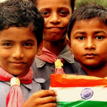 "Title: Freedom Savers ""This picture was captured at the IIT campus in Kanpur. Just after the flag hoisting ceremony I saw these kids with the Indian flag. It seemed as if they were taking in the essence of freedom."" Camera: Sony Cyber-shot DSC-H50 ISO: 100 Aperture: f/4 Shutterspeed: 1/250sec Photograph/Senthil, Kanpur"