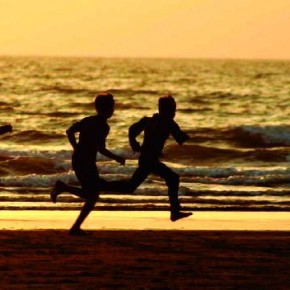 The three figures of the children running on the beach add to an otherwise plain shot. Photograph/Rajeev BR