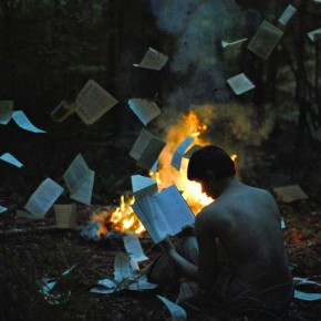 My mother, brother, and I worked as a team to create this image, building a campfire and tossing torn pages about like a tornado. The smell of fire stayed in our clothing for a month. Photograph/Alex Stoddard