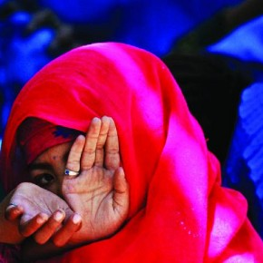 Near Kabul, 2003: This photograph of a girl shying away from the camera was made at a refugee camp. Photograph/Arko Dutta, Reuters