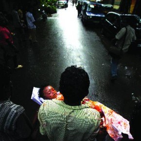Mumbai, 2005: Several people, including seven children were killed in a stampede after rumours spread about a lake bursting its bank. Here, a man is seen carrying the body of his three-year-old nephew. Photograph/Arko Dutta, Reuters