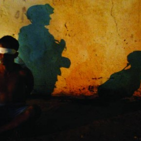 Baghdad, 2003: This photograph was shot when the US army used to conduct raids almost every night for suspected Saddam Hussein loyalists. No fl ashes were allowed for photographers. Here, the shadows of a US soldier and detainee are cast on a wall after a raid. Photograph/ Arko Dutta, Reuters