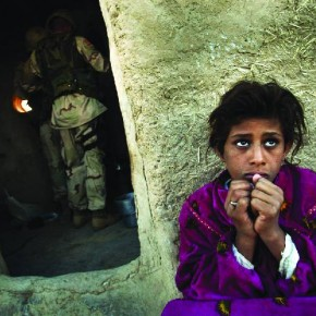 Iraq, 2003: An Iraqi girl reacts as US soldiers search her house during a joint raid with the Iraqi police. Seven persons were arrested during the raid. Photograph/Arko Sutta, Reuters