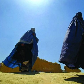 Kabul, 2003: Afghan war widows are seen walking in a queue to get their monthly rations. Photograph/Arko Sutta, Reuters