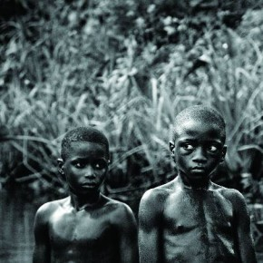Two children pause while swimming in a stream. The former General claimed that he would sometimes swim into a river, kidnap children by dragging them underwater and carry them away to be ritually murdered. Photograph/Ryan Lobo