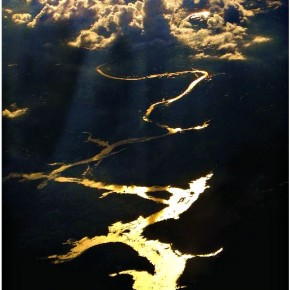 "Title: Gold Rush ""This shot was taken while I was on an aircraft that was flying over Maharashtra. I tried to use an unusual angle to capture the sun rays, falling from behind a cluster of clouds onto a meandering river. The photograph has not been cropped or edited, except for minor colour adjustments."" Camera: Canon PowerShot S3 IS Aperture: f/4 Shutterspeed: 1/1000sec Photograph/ Bhaskar Dutta, Bengaluru"