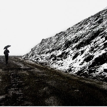 "Title: Snowfall ""I was on my way to Ladakh and it was snowing, when I saw this man with an umbrella walking on the road, out in the distance. I thought it was a perfect combination for a black and white photograph."" Camera: Nikon D100 ISO: 200 Aperture: f/14 Shutterspeed: 1/125sec Photograph/ Bobby Sharma, Ludhiana"