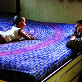 This is a common scene in my house. A wonderful moment is shared between my wife and our daughter, as she plays on the cotton bedspread. Photograph/Manish Chauhan, Freelance photographer, Vadodara, Gujarat