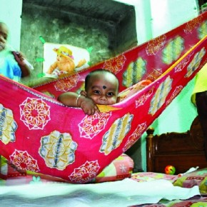 At my relative's house, I saw this baby. He seemed wonderfully merry in his cotton paalna, or cradle. As he smiled, I managed to make this picture. Photograph/Sukanta Mondal, Railway employee, Hooghly, West Bengal