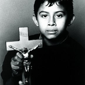 The Christ Bearer, 2000: This image is a powerful and beautiful portrait of a sombre-eyed Latino boy, whose parents have died of AIDS. Photograph/Kurt Weston