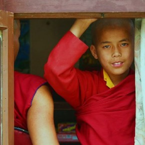 "Title: Young Monk ""I had gone to a monastery at Sarnath, Uttar Pradesh, when I noticed a few young monks hiding behind the door and being reprimanded by an elderly man. It took patience to wait there for the right moment, but eventually I managed."" Camera: Canon EOS 400D Lens: Canon 18–55mm ISO: 100 Aperture: f/5.6 Shutterspeed: 1/25sec Photograph/ Rakesh C Maurya, Lucknow"