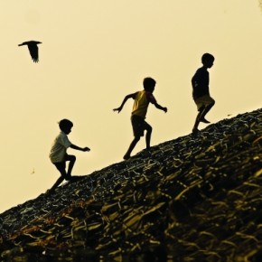 The gestures of the boys, their position in the frame and the two crows, make a brilliant moment. Exposure: 1/800sec at f/5.6 (ISO 100). Photograph/Alok Brahmbhatt