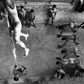 Pehalwans practise rope climbing at the Kalyan Puri akhara, Delhi. This exercise is essential to develop the pulling strength required in kushti. Photograph / Idris Ahmed