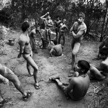 After a gruelling session at the akhara, some pehalwans relax and wash the soil off their bodies. Photograph / Idris Ahmed