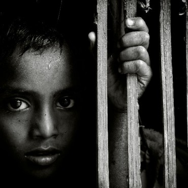 """While visiting the underdeveloped outskirts of Kolkata, I noticed this boy peering at me through his windows. His innocence and the intensity in his eyes prompted me to make this photograph."" Photograph/Supriyo Ranjan Sarkar"