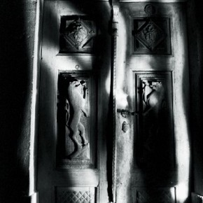 This is the door of the room where Bavčar's mother was born. He light painted the door frame to revere his mother's place of birth. Photograph/Evgen Bavčar