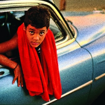 This photograph of a boy in a vintage Chevrolet car is one of David's most famous images and was also used as the cover of his book Cuba. Photograph/ David Alan Harvey