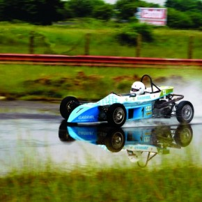 I set a fast shutterspeed to freeze the car as it crossed this stretch of water at the Chennai Race Track. Exposure: 1/200sec at f/7.1. Photograph/Suresh Narayanan