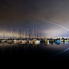 This image of a plane taking off and going over a marina was an 80sec long exposure, made at f/5. Photograph/Terence Chang