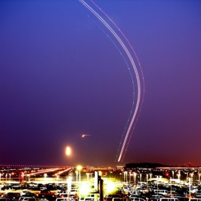 An exposure of 26sec, this high contrast image shows a plane taking off during twilight. Photograph/Terence Chang