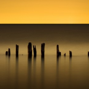 In this 142sec exposure of a late sunset at a pier, one can see how the water has been rendered into a smooth, yet graphic blur. Photograph/John Ryan