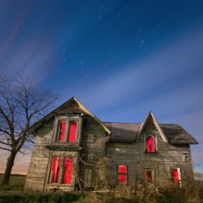 The photographer has fired an external flashgun covered with a red gel, from inside the house. This, combined with the star trails, has created an eerie setting. Photograph/John Ryan