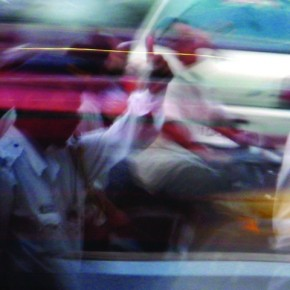 Traffic in Mumbai is characterised by its disorderliness. I focused on the traffic cop while keeping the shutter speed at 1/6sec. I released the shutter while the bus was passing by. Photograph/Raj Lalwani