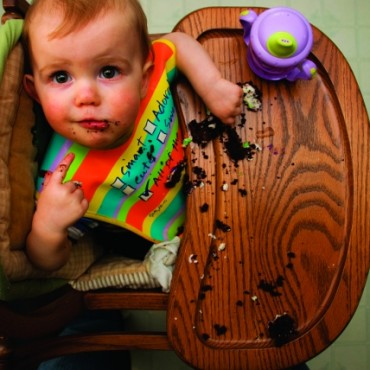 Take advantage of your child's daily activities, like the feeding time, to shoot messy yet adorable pictures. Experiment with vantage points to enhance the mood of the picture. Photograph/Brian Cooper