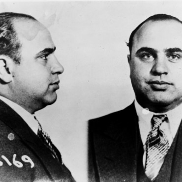 This is a prisoner portrait of Alphonse Capone, better known as Scarface, who was arguably America's most famous gangster. Image Source: Wikimedia Commons