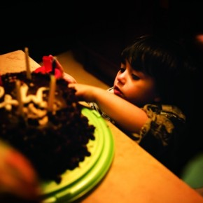The birthday cake gives a number of opportunities to shoot interesting photographs. This photograph effectively depicts the birthday kid's curious expressions. Photograph/Gio Zizzo