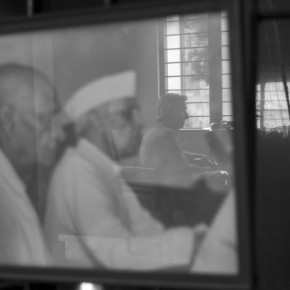 Homai is seen reflected in a frame containing a photo of Jawaharlal Nehru and Sardar Vallabhbhai Patel. She had only three photographs displayed in her house. Photograph/Ishaan Dixit