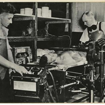 Captain Albert King, Chief of X-ray Service, makes a fluoroscope of a patient's chest at the US Army Station Hospital in India.