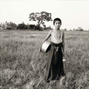 Young Rato monk delivering milk. Tree behind Nandigaddi. Photograph/Nicholas Vreeland/ Tasveer Arts